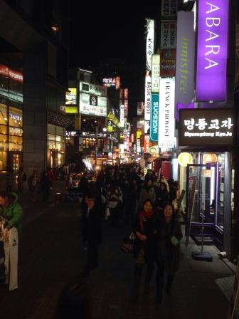 Street vendors along Myeong- dong at night