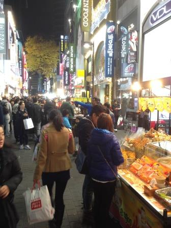 Street Vendors and Flagship Department Stores along Myeong- dong
