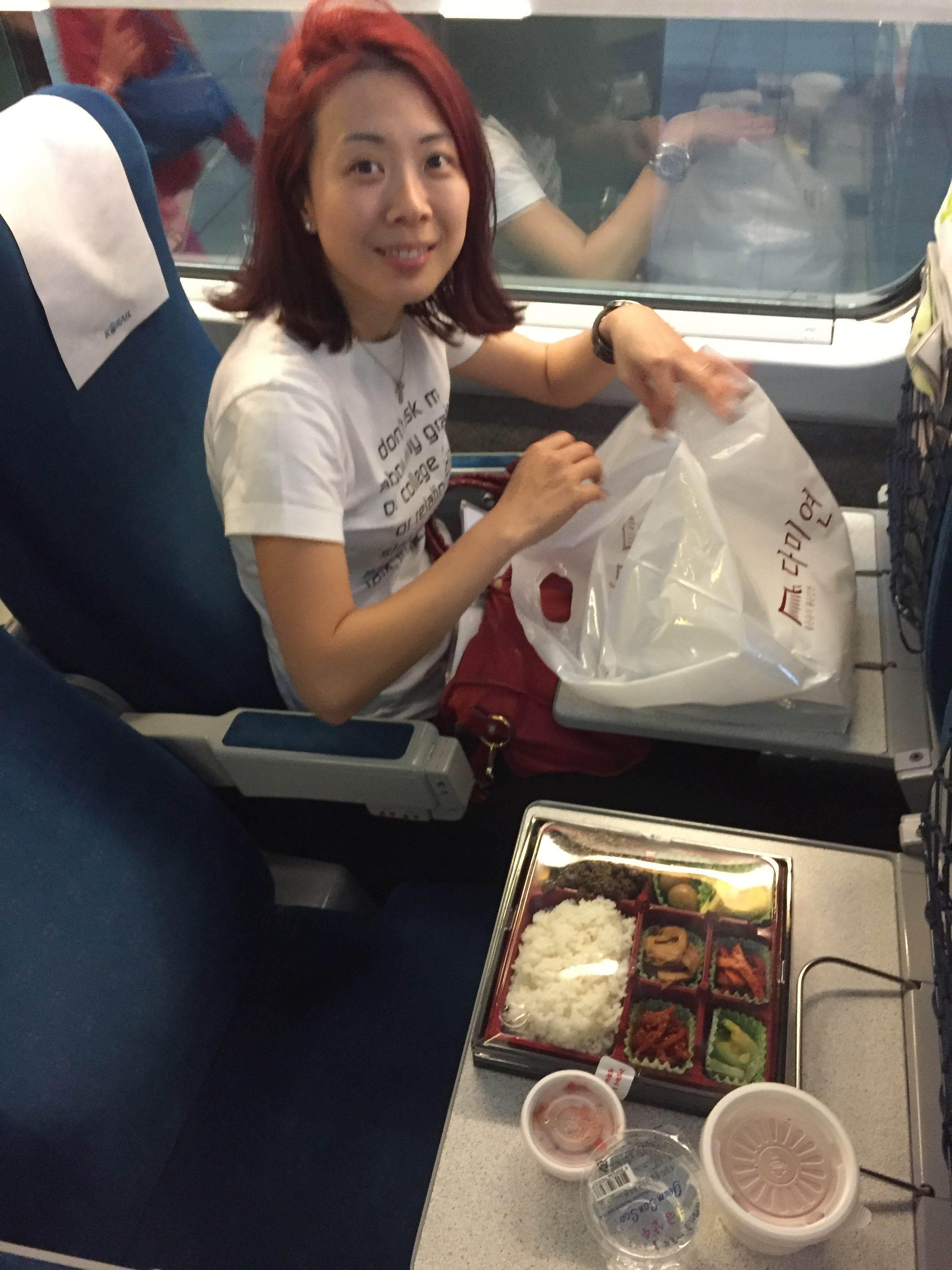 Brenda looking really happy with her bento dinner