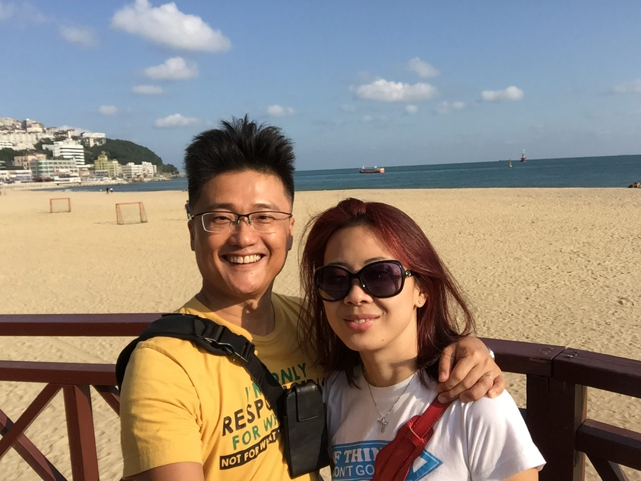 a selfie of me and my wife Brenda on haeundae beach